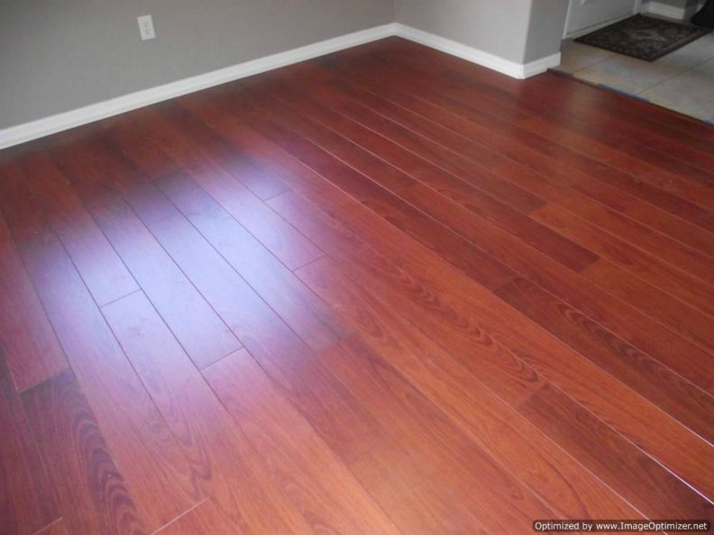 Quick Step Perspective laminate installed in a dinning room