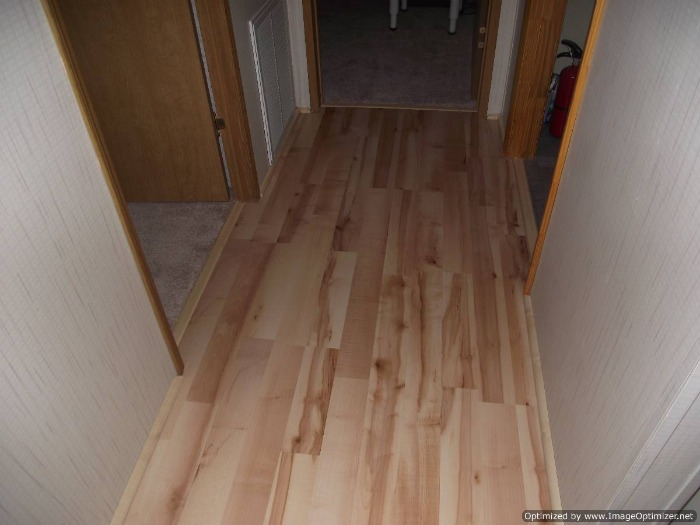 Quick Step Home Sound Blonde Maple laminate flooring installed in the hall way.