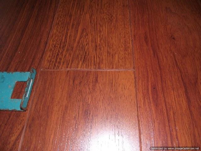 Harmics Brazilian Cherry laminate flooring with beveled edges, made by Unilin