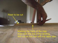 Installing laminate flooring on angled stairs, marking the back of the riser so it can be cut flush at the top of the step for the stair nose.