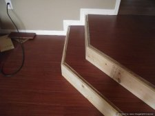 Installing laminate flooring on angled stairs, after the laminate tread is glued and the top landing installed, the stair nose can be installed.