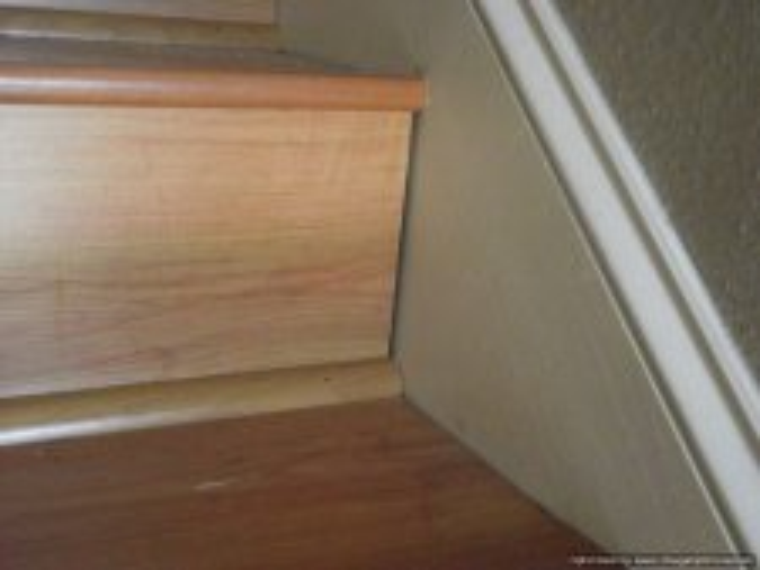 Bad laminate stair installation.