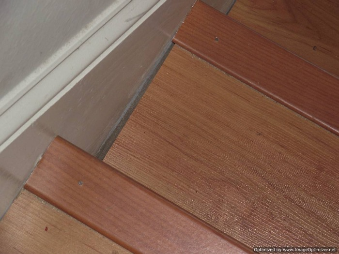 Bad laminate stair installation.
