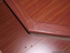Installing laminate flooring on angled stairs, use construction adhesive to glue the stair nose on, and then nail about every foot or so to ensure they are attached securely.