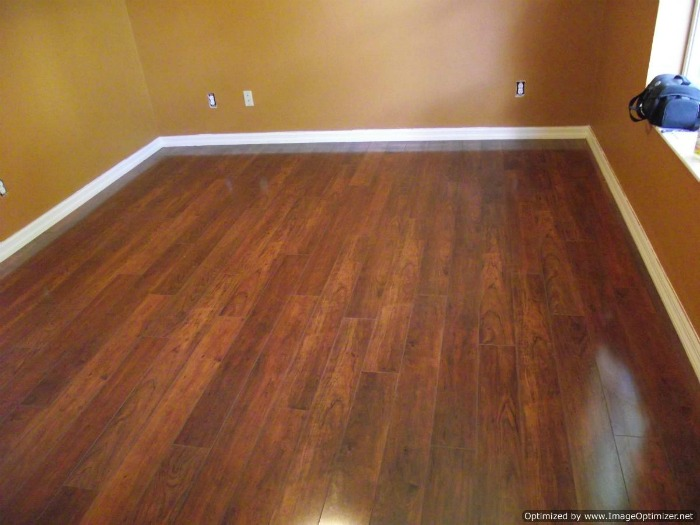Swiftlock high gloss laminate flooring installed in a bedroom.