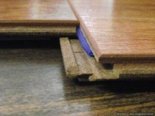 Lowes, Casual Living Berkshire Cherry laminate, shows close up of the end joint after its connected.