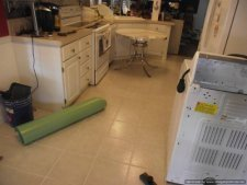 Laminate flooring in kitchen over ceramic tile installation