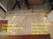 Use a small piece of transition to mark each side of the doorway so you will know where to end the laminate flooring in the doorway.