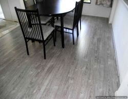 Shaw Gray laminate flooring installed in dining room