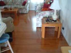 Vanier laminate flooring Color:Doussie installed in living room photo