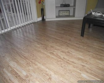 Kensington Manor Dream Home laminate flooring installed in a living room