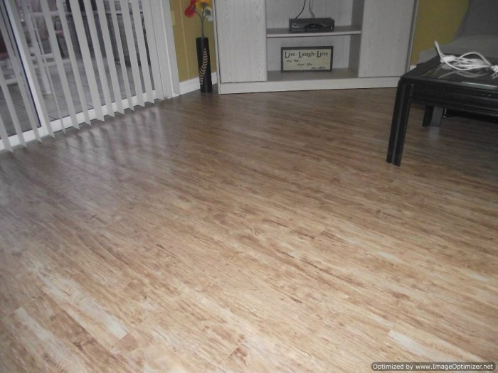 Kensington Manor Dream Home laminate flooring installed in a living room
