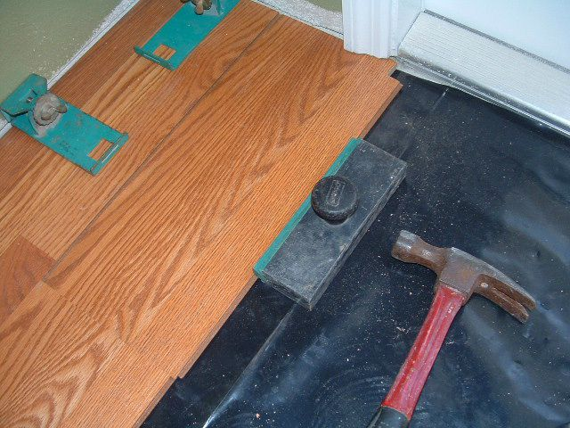 Harmonics laminate flooring installation, I installed a couple of rows into the hallway from the living room. This is the other end of the hallway