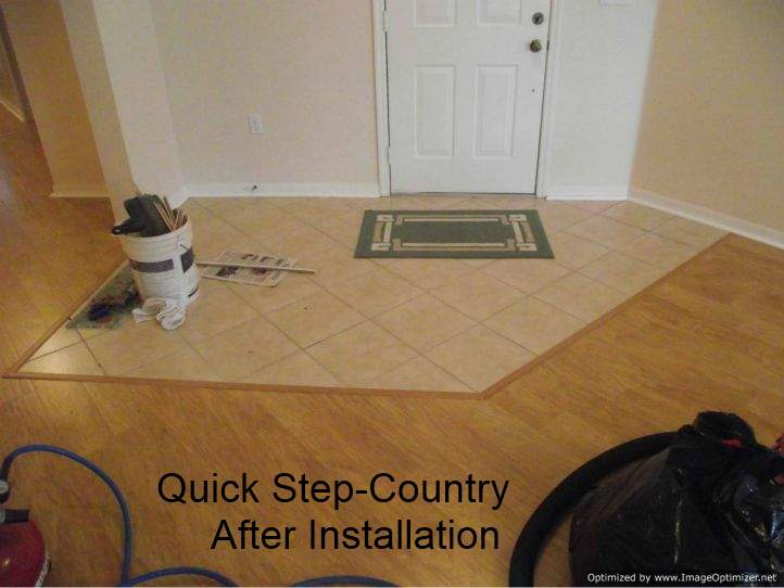After photo, Installed Quick Step laminate flooring up to ceramic entry