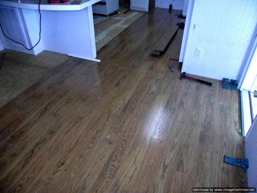 Pergo Xp Laminate Flooring Begining Of Installation Into Kitchen From The Dining Room