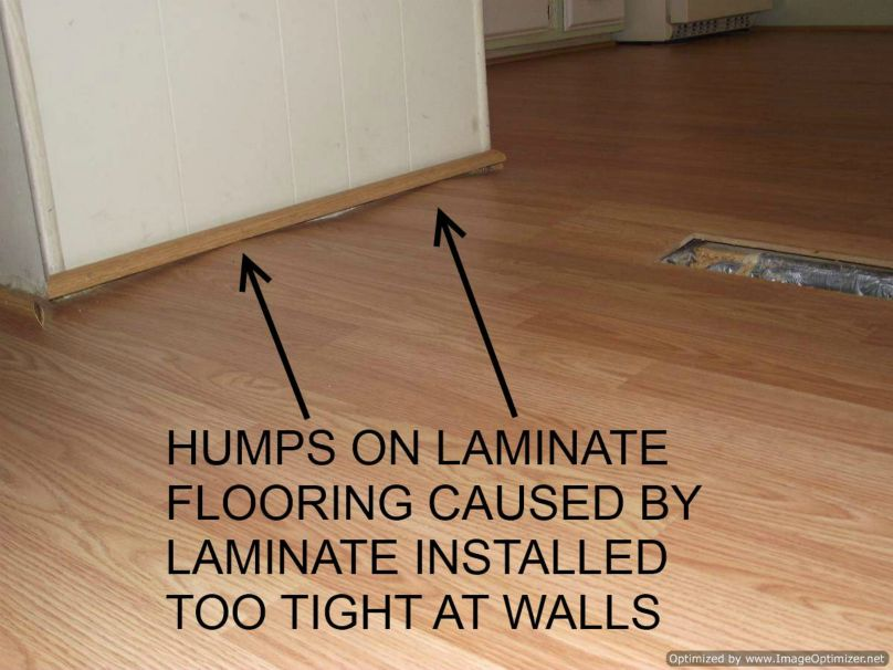 Bad Laminate flooring installation shows the floor peaking up - Bad Laminate Installation, Repair