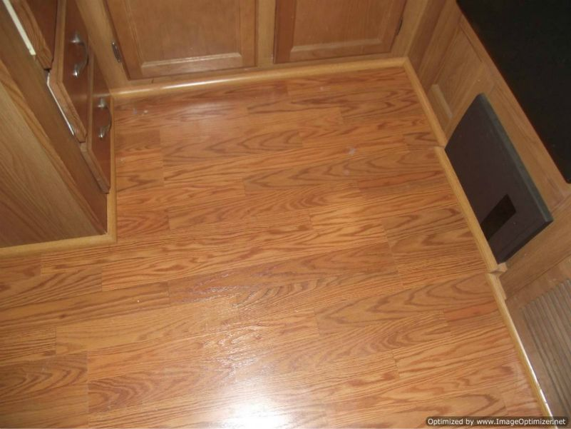 Installing laminate flooring in a travel trailer, installed quarter in the kitchen