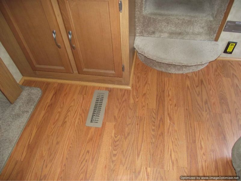 Installing laminate flooring in a travel trailer, installed quarter round by step