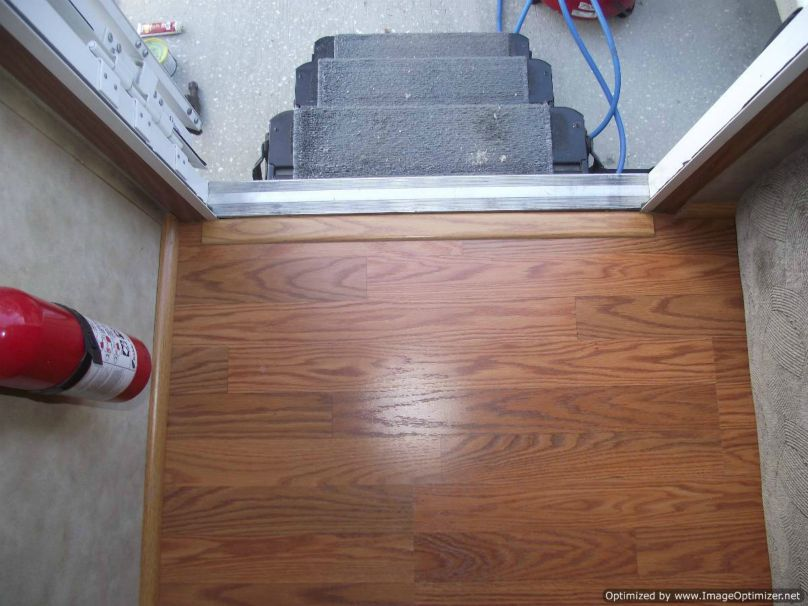 Installing laminate flooring in a travel trailer, installed transition at entry door