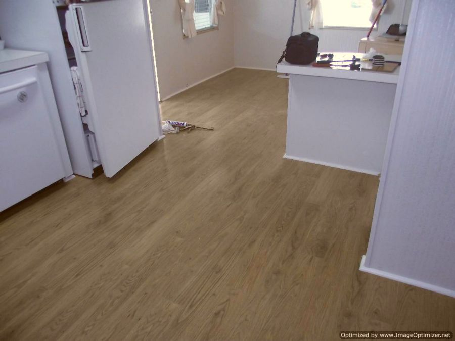 Pergo XP laminate flooring installed in kitchen and dining room.