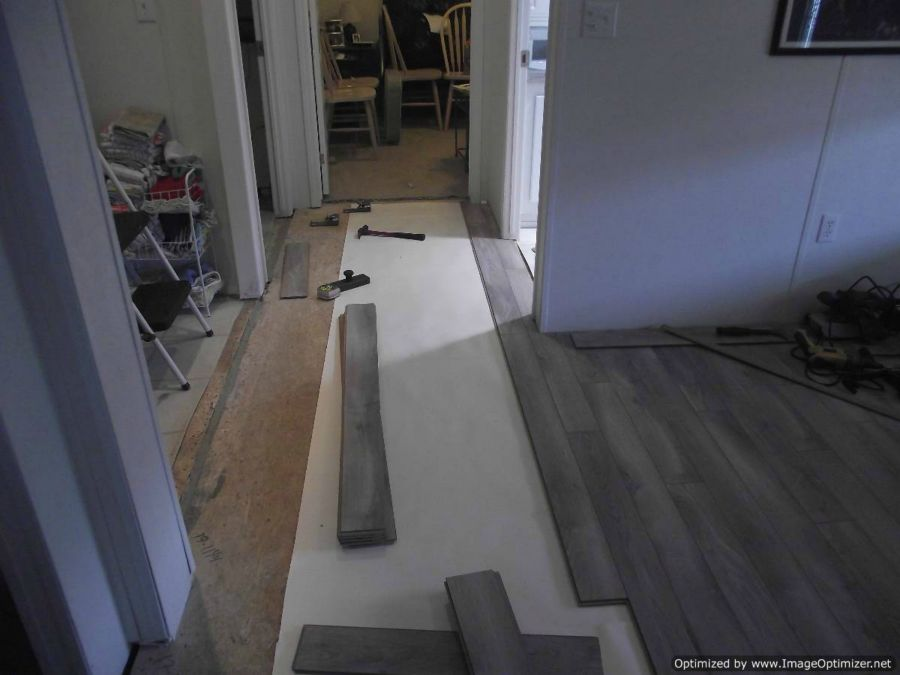 Nirvana V-groove laminate flooring installation, doing hallway installation around corner
