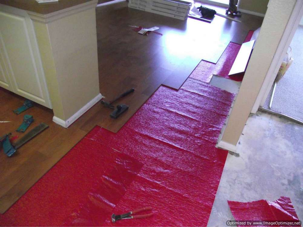Water Damaged Laminate Flooring Removal From Hallway Into Living Room