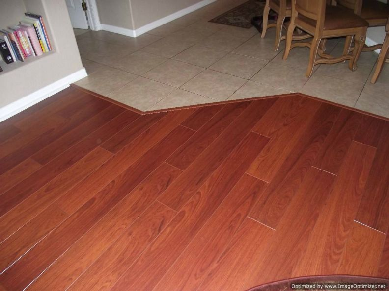 Quick Step Perspective laminate installed up to ceramic tile