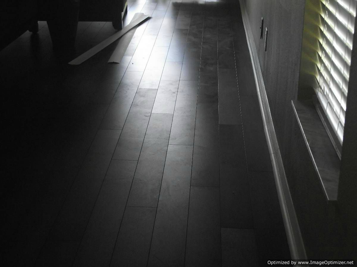 Lamton Virginia walnut laminate flooring, showing defect on the finish