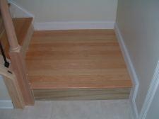 Bottom landing finished with hardwood flooring