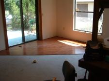 Undercutting a fireplace to install laminate or hardwood flooring under it.