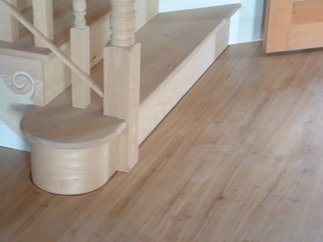 Installing laminate or hardwood around a curved staircase.