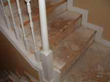 Close up photo after I cut the over hang off the stairs so I can install laminate flooring on the stairs.