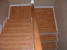 Here is the finished stair case after I installed the laminate flooring on them