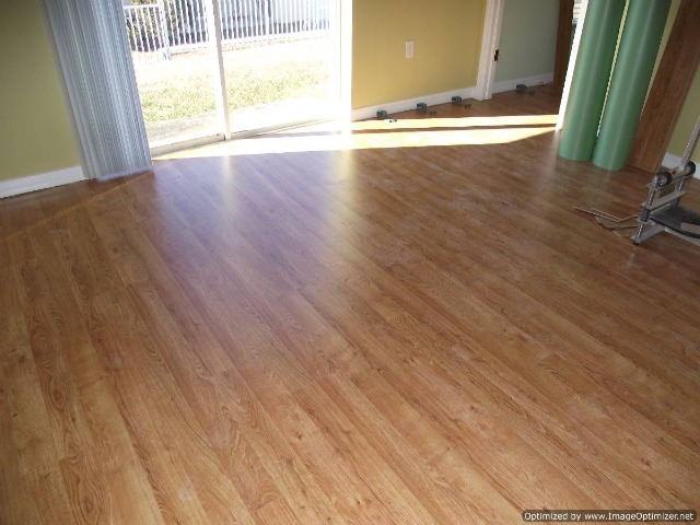 Quick Step 700 series Golden Oak 7mm laminate flooring installed in the living room
