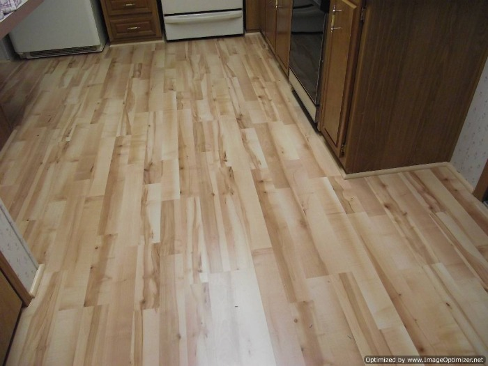 Quick Step Home Sound Blonde Maple Laminate Flooring Installed In The  Kitchen And Hall Way.
