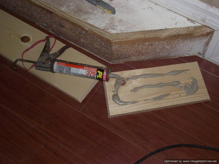 Installing laminate flooring on angled stairs, position the stair nose on the riser so it sits level.