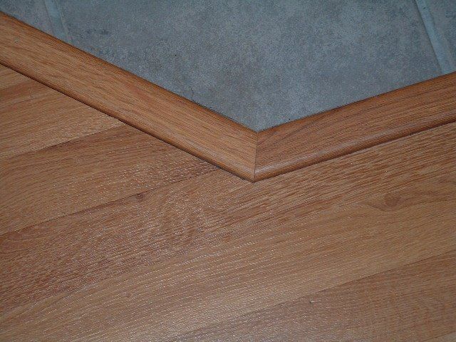 Flexible Floor Transition http://www.laminate-flooring-installed.com/modifying-laminate-transitions.html