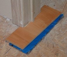 A sample of laminate and uderlayment for checking the height  when cutting your door casing