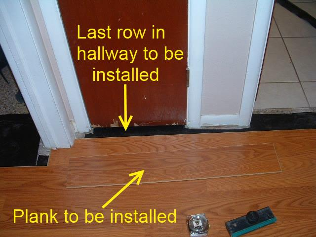 Hallways, here is where the last row of laminate flooring will be installed in the hallway under door jamb.