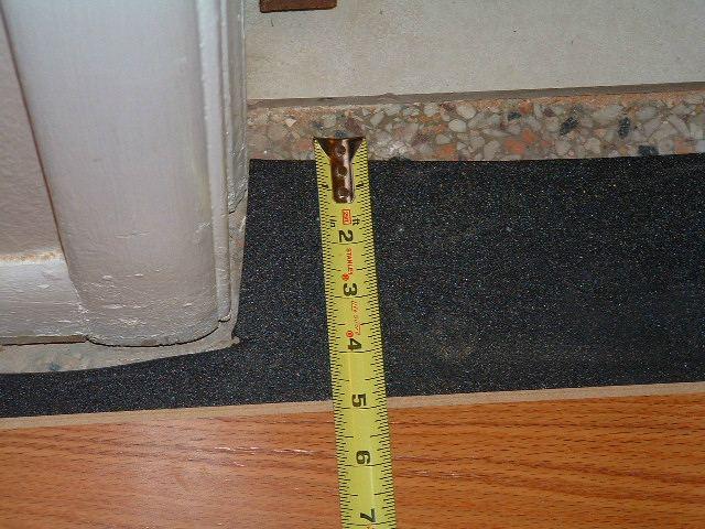 Hallways, installing the last row of laminate flooring in hallway at the ceramic tile in the bathroom doorway.