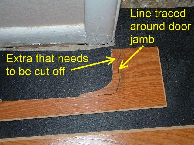 Hallways, when installing the last row of laminate flooring in hallway under door jamb, its good to trace around the door jamb to see if it needs anymore cutting.
