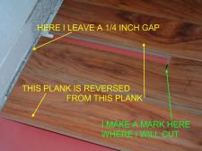 Marking the last plank to cut to fit lamton laminate