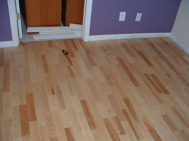 Karhs Kalmar Ash floating wood flooring installed in a bedroom