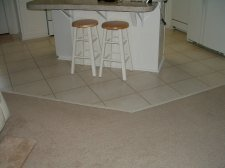Quick step laminate tile installed in a grid pattern like real ceramic tile