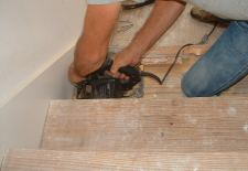 Here I'm cutting the over hang with a circular saw off the stair