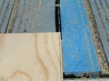 Scribing the bottom of the riser for installing laminate flooring on stairs.