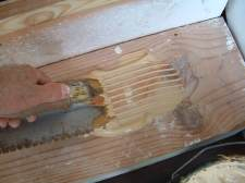 I am using a wood glue to glue the laminate flooring tread down as I install laminate flooring on these stairs.