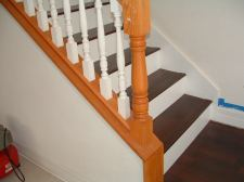 Mohawk laminate flooring from Lowes installed on these stairs with a white painted riser