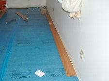 Here I am installing the first row of laminate flooring