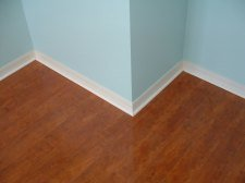 Horizon laminate flooring installed with the quarter round, purchased from Flooring America